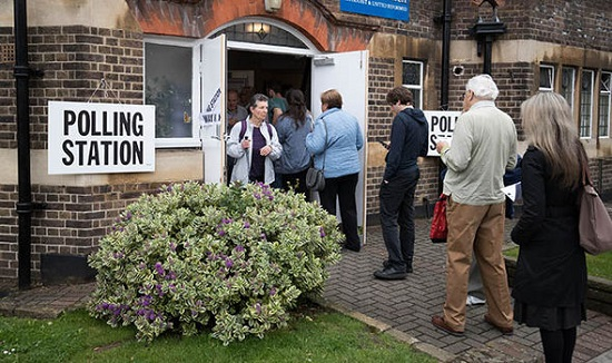 British voters at election polling station